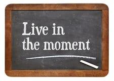 Leben Sie im Moment Stockbild
