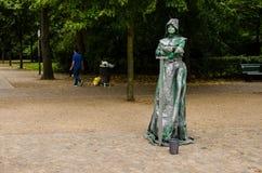 Lebende Statue in einem Park, Berlin Stockbild