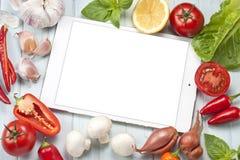 Lebensmittel-Gemüse-Tablet-Hintergrund Lizenzfreie Stockbilder
