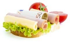 Lebensmittel und Geld Stockfotos