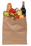 Lebensmittelgeschäfte einschließlich Früchte, Gemüse und eine Weinflasche Stockfoto
