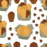 Lebensmittelsammlung köstliche madeleines mit nahtlosem Muster der Haselnusses Stockfoto