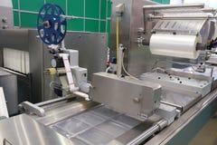 Lebensmittelverpackungs-Industrieausrüstung Stockfotos