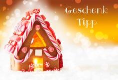 Lebkuchen-Haus, goldener Hintergrund, Geschenk Tipp bedeutet Geschenk-Tipp Stockbild