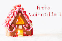 Lebkuchen-Haus, weißer Hintergrund, Frohe Weihnachten bedeutet frohe Weihnachten Stockfoto