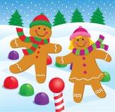 Lebkuchen-Junge und Mädchen im Schnee Lizenzfreies Stockfoto