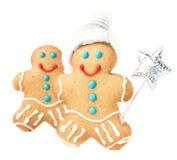 Lebkuchen-Mann-Weihnachtsplätzchen mit Sankt-Hut und Magie haftet Stockbilder