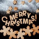 Lebkuchen-Plätzchen, Glückwunsch mit frohen Weihnachten Stockbild