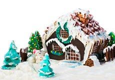 Lebkuchenhaus und -süßigkeit für die frohen Weihnachten des Feiertags Stockbild