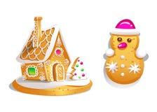 Lebkuchenhaus verzierte Süßigkeitszuckerglasur und -Schneemann Weihnachtsplätzchen, selbst gemachtes gebackenes süßes Lebensmitte Lizenzfreie Stockbilder