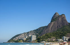 Leblon beach and mountain Dois Irmao (Two Brother) Royalty Free Stock Images