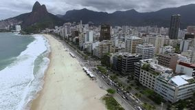 Leblon Beach and Vidigal slum in the background, Rio de Janeiro Brazil. Cloudy day. Without sun stock footage