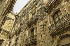 Lecce: Baroque streets. Lecce: Baroque balconies of an historic building Royalty Free Stock Images