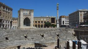 Lecce, Italy - August 2, 2017: panoramic view of Roman amphitheater with palaces of the Sedile and the INA Istituto Nazionale del. Le Assicurazioni in Sant` stock video footage