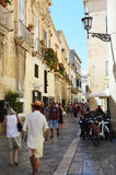 LECCE, ITALY - AUGUST 2, 2017: view of old cozy street in Lecce, Italy. Architecture and landmark of Lecce, Italy Royalty Free Stock Image