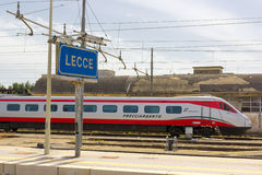 LECCE, ITALY- MAY 2016: A Trenitalia train arrives in the railway station of Lecce Stock Photo