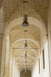 Lecce, lamps aligned in a convent. Lecce, Convent of the Theatine, detail lamps in the naves Stock Images