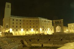 Lecce by night, roman amphitheatre. And sedile in saint Oronzo place, sample of Italian barocco Royalty Free Stock Photography