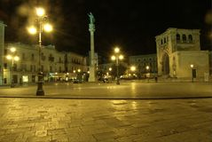 Lecce by night, saint Oronzo place stock photography