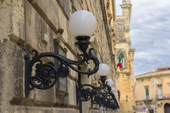Lecce, street lamps. Aligned on the wall Royalty Free Stock Images