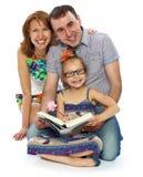Lecciones de la verificación de los padres en la hija Fotos de archivo libres de regalías