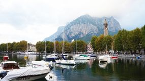 LECCO, ITALY - SEPTEMBER 11, 2017: Lake Como harbor with boats and ships in the town of Lecco, Italy Stock Photo