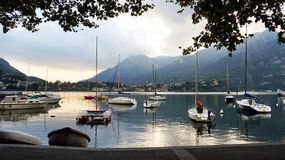 LECCO, ITALY - SEPTEMBER 11, 2017: Lake Como harbor with boats and ships in the town of Lecco, Italy Stock Photography