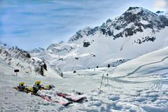 Lech Zurs ski resort, Arlberg, Tyrol, Austria. Skis and snow - taking a rest from skiing at a mountainside restaurant with a view of the pistes, ski trails, and Stock Photos