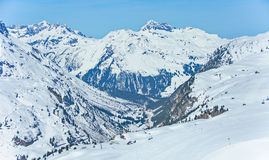 Lech Zurs ski resort, Arlberg, Tyrol, Austria. View of the pistes, ski trails, and mountains of the Lech Zurs ski resort, part of the Arlberg  ski area, from a Royalty Free Stock Photography