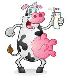 Leche de consumo de la vaca retra Fotografía de archivo libre de regalías