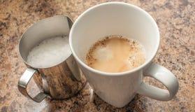 Leche y café express Imágenes de archivo libres de regalías