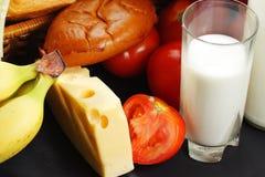 Leche y queso con el otro alimento Imagen de archivo libre de regalías