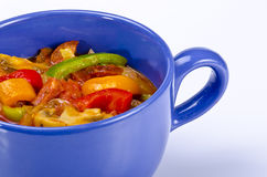 Lecho. Is an originally Hungarian thick vegetable stew which features peppers and tomato, onion, lard, salt, sugar and ground paprika  as a base recipe Royalty Free Stock Image