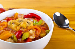 Lecho. Is an originally Hungarian thick vegetable stew which features peppers and tomato, onion, lard, salt, sugar and ground paprika  as a base recipe Stock Photos