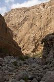 Lecho de un río seco Shab, sultanato de Omán Foto de archivo libre de regalías