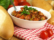 Lecho with frankfurters. Delicious lecho with frankfurters and green peas Stock Photos