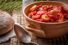 Lecho - stew with peppers, onions and sausages. Royalty Free Stock Images