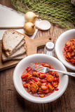 Lecho - stew with peppers, onions and sausages. Stock Photography