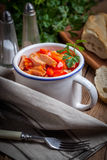 Lecho - stew with peppers, onions and sausages. Stock Photo