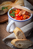 Lecho - stew with peppers, onions and sausages. Stock Photos