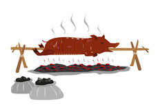 Lechon or Suckling Pig on a rotating stick  Royalty Free Stock Photos