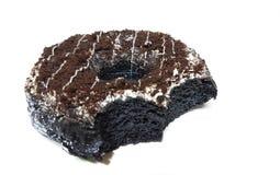 Leckere Bisse des Schokoladendonuts Stockbild