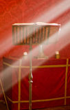 Lectern in altar with a holy bible. Lectern in altar with a holy bible and a ray of divine light royalty free stock photography