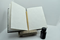 Lectern, pen, inkwel. L on white background royalty free stock photos