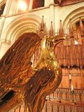 Lectern Peterborough Cathedral. Eagle lectern with choir in background Stock Photos