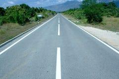 Lecteur de route droite Photographie stock libre de droits