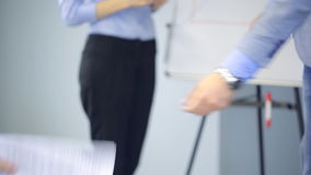 Lector spreads handouts between listeners in conference hall. stock footage