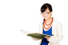 Lectura de la mujer de negocios Foto de archivo