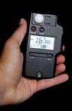 Lectura del fotómetro en estudio Foto de archivo libre de regalías
