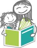 Lectura y niño Foto de archivo libre de regalías